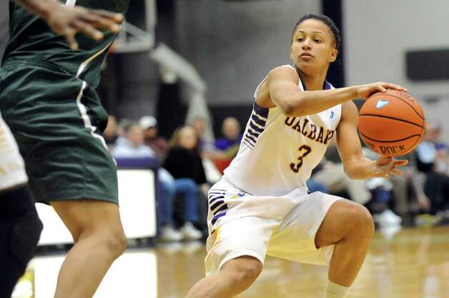 UAlbany's Margarita Rosario, right, looks to pass during their basketball game against Binghamton on Wednesday, Feb. 11, 2015, at SEFCU Arena in Albany, N.Y. (Cindy Schultz / Times Union) Photo: Cindy Schultz / 00030541A