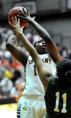 UAlbany's Imani Tate, left, shoots for the hoop as Binghamton's Imani Watkins defends during their basketball game on Wednesday, Feb. 11, 2015, at SEFCU Arena in Albany, N.Y. (Cindy Schultz / Times Union) Photo: Cindy Schultz / 00030541A