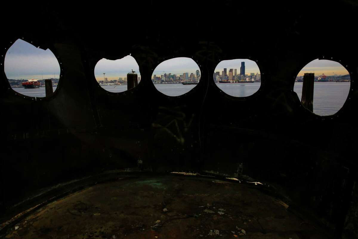 In what will almost certainly become an iconic view of the Seattle skyline, the city is shown through the wheelhouse windows of the historic ferry Kalakala outside of Salty's on Alki. Salty's restaurant owner Gerry Kingen purchased parts of the historic ferry Kalakala after the ship was dismantled. After years of efforts to preserve the ferry, it finally met its end at a graving dock in Tacoma. Photographed on Wednesday, February 11, 2015.