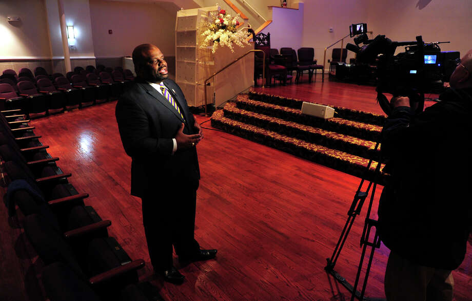Pastor Kenneth H. Moales, Jr. speaks to the media after a service at his church The Cathedral of the Holy Spirit in Bridgeport, Conn. on Wednesday Feb. 11, 2015. Rev. Al Sharpton made a guest appearance via a taped video message during the service. Photo: Christian Abraham / Connecticut Post