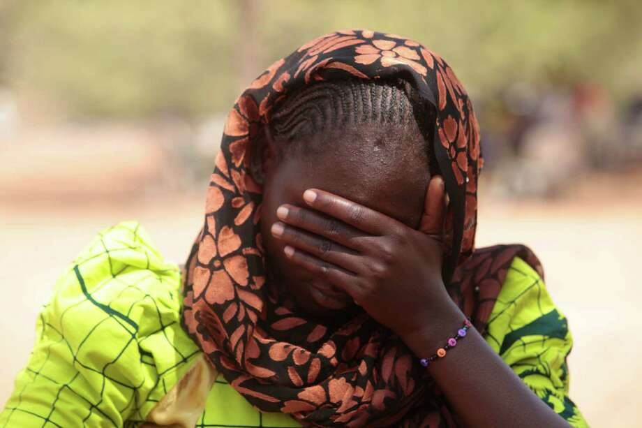 Dorcas Aiden, who had been abducted by Boko Haram, said she was beaten with a gun  when she refused to marry a member of the terror group.  Photo: Lekan Oyekanmi, STF / AP