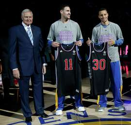 Klay Thompson (center) and Stephen Curry received their All-Star Game jerseys from Warriors executive Jerry West, left, before the team's Feb. 4 game against Dallas. Thursday, coach Steve Kerr announced that Thompson will join Curry in the Western Conference starting lineup in Sunday's game.