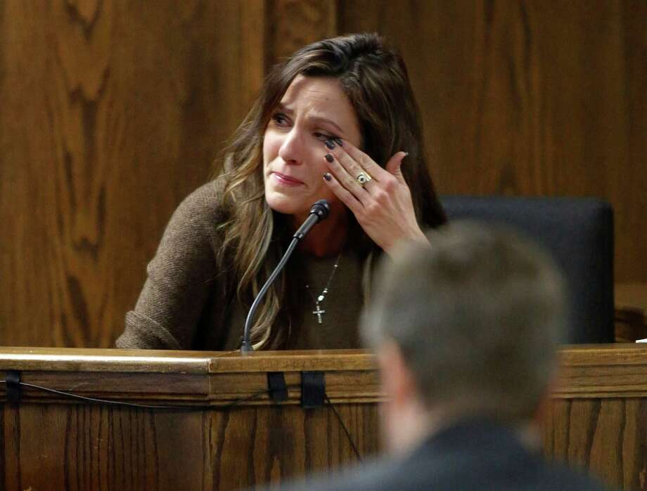 Taya Kyle, wife of slain Navy SEAL Chris Kyle, wipes her eyes as she testifies during former Marine Cpl. Eddie Ray Routh's capital murder trial at the Erath County Donald R. Jones Justice Center, Wednesday, Feb. 11, 2015, in Stephenville, Texas. Photo: Tom Fox, POOL / Pool The Dallas Morning News