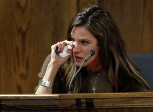 Taya Kyle, wife of slain Navy SEAL Chris Kyle, wipes her eyes as she testifies during former Marine Cpl. Eddie Ray Routh's capital murder trial at the Erath County Donald R. Jones Justice Center, Wednesday, Feb. 11, 2015, in Stephenville, Texas. Routh, 27, of Lancaster, Texas, is charged with the 2013 deaths of Kyle and his friend Chad Littlefield at a shooting range near Glen Rose, Texas. (AP Photo/The Dallas Morning News, Tom Fox, Pool)