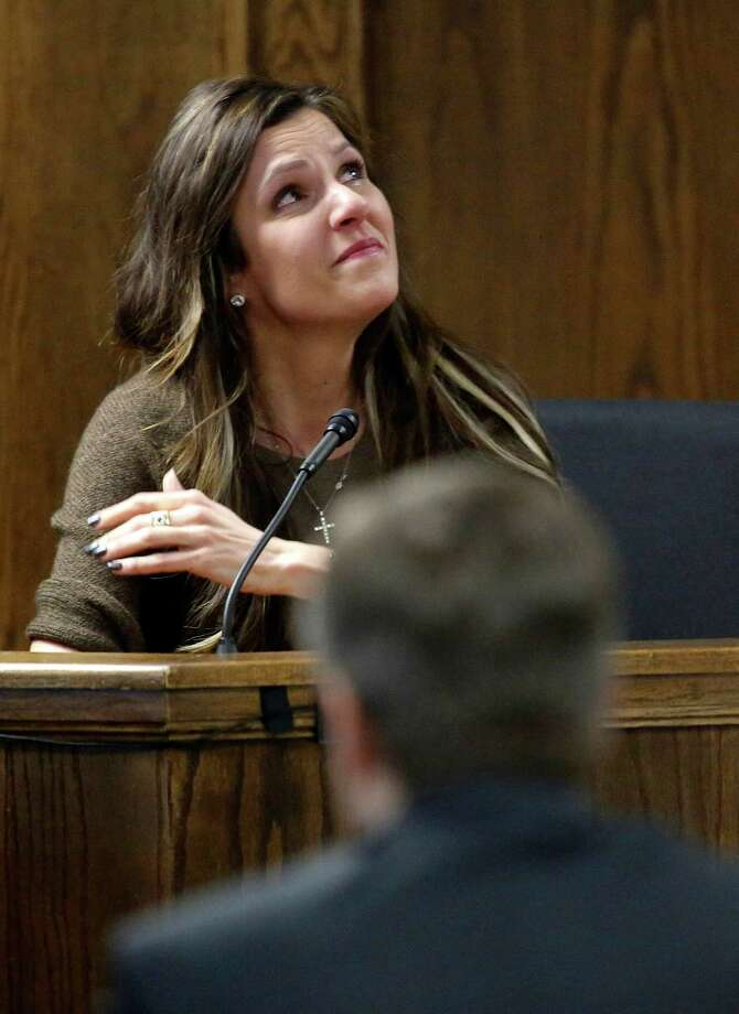 Taya Kyle, wife of slain Navy SEAL Chris Kyle, looks skyward as she talks about her late husband while testifying during former Marine Cpl. Eddie Ray Routh's capital murder trial at the Erath County Donald R. Jones Justice Center, Wednesday, Feb. 11, 2015, in Stephenville, Texas. Routh, 27, of Lancaster, Texas, is charged with the 2013 deaths of Kyle and his friend Chad Littlefield at a shooting range near Glen Rose, Texas. (AP Photo/The Dallas Morning News, Tom Fox, Pool) Photo: Tom Fox, POOL / Pool The Dallas Morning News