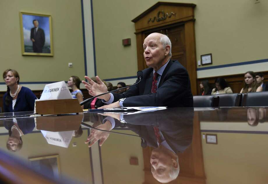 FILE - In this July 23, 2014 file photo, IRS Commissioner John Koskinen testifies on Capitol Hill in Washington. Under pressure from Congress, the IRS has apologized for seizing banks accounts from otherwise law-abiding business owners simply because they structured bank transactions to avoid federal reporting requirements. The business owners' alleged crime: They routinely made bank deposits of less than $10,000. That allowed them to avoid reporting requirements designed to catch drug dealers and money launderers. Koskinen told Congress Wednesday the tax agency is changing its policies to prevent the seizures, as long as the money came from legal means. (AP Photo, File) Photo: Uncredited, STF / AP