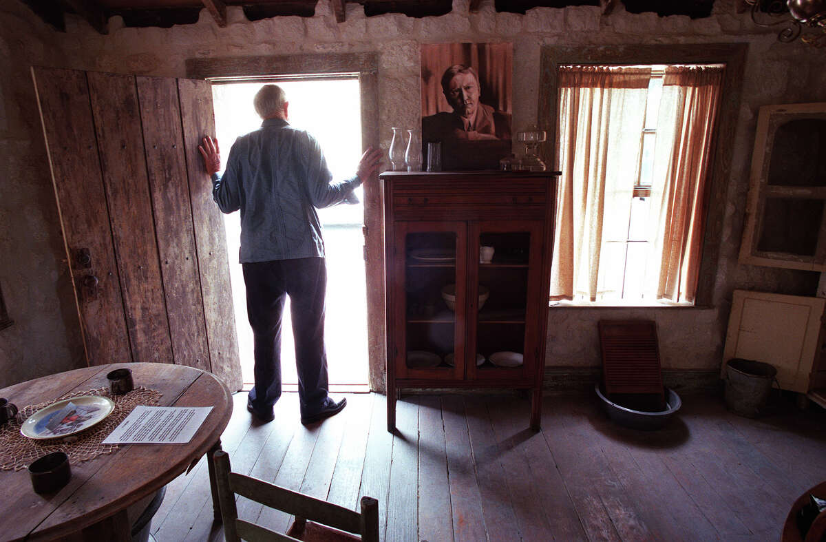 David Carter, shown in the O. Henry House in 1999, was instrumental in preserving and restructing the historical site.