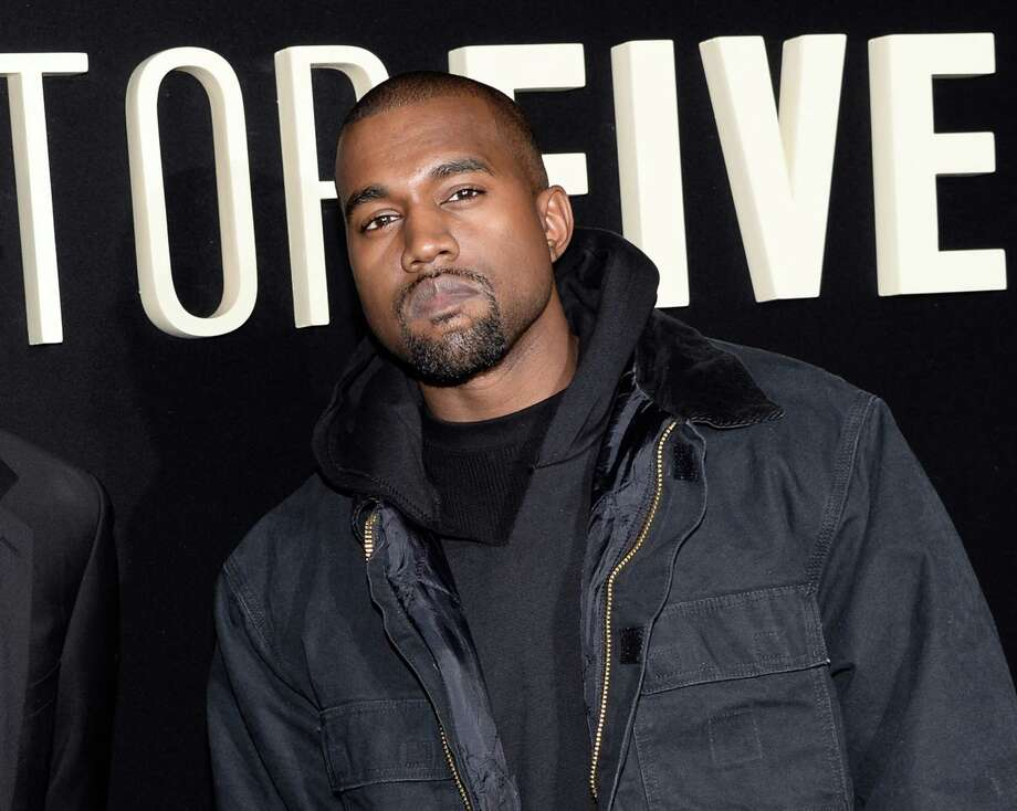 """FILE - In this Dec. 3, 2014 file photo, Kanye Wests attend the premiere of """"Top Five"""" at the Ziegfeld Theatre in New York. West paid a visit on Ryan Seacrest and his """"On Air"""" radio show Wednesday, Feb. 11, 2015, to expound on his post-Grammy diss of the Album of the Year winner, Beck. The rapper walked up the steps at the Staples Center in Los Angeles as Beck was accepting his award Sunday night but retreated. During an aftershow on E!, West ranted that Beck should """"respect artistry"""" and turn over his statue to fellow nominee Beyonce. West told Seacrest of his stair-climbing antics: """"It was kind of a joke like the Grammys themselves."""" (Photo by Evan Agostini/Invision/AP, File) Photo: Evan Agostini, INVL / Invision"""