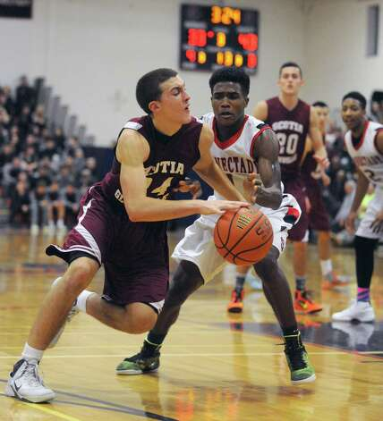 Scotia-Glenville's Joe Cremo drives to the basket defended by Schenectady's Neftali Lind during the final of the Hilliard boys' basketball tournament on Tuesday Dec. 30, 2014 in Schenectady, N.Y. (Michael P. Farrell/Times Union) Photo: Michael P. Farrell / 00030013A