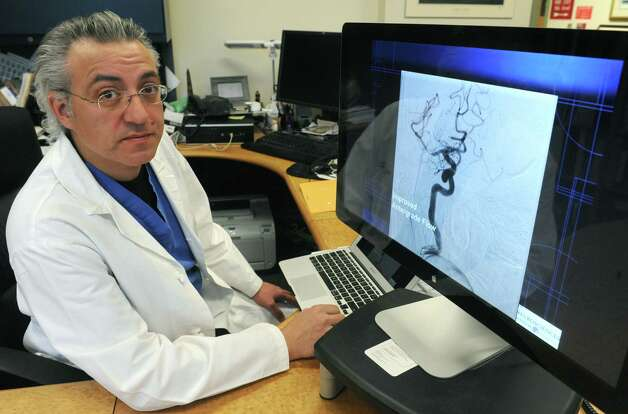 Neurosurgeon Dr. Alan Boulos at Albany Medical Center on Tuesday Feb. 10, 2015 in Albany , N.Y.  (Michael P. Farrell/Times Union) Photo: Michael P. Farrell / 00030552A