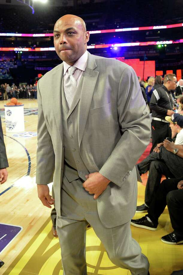 """When Rockets GM Daryl Morey, left, took Charles Barkley to task Tuesday for his """"misinformed biased vitriol,"""" the TNT analyst disparaged Morey and his team's NBA title prospects. Photo: Mike Coppola, Staff / 2014 Getty Images"""