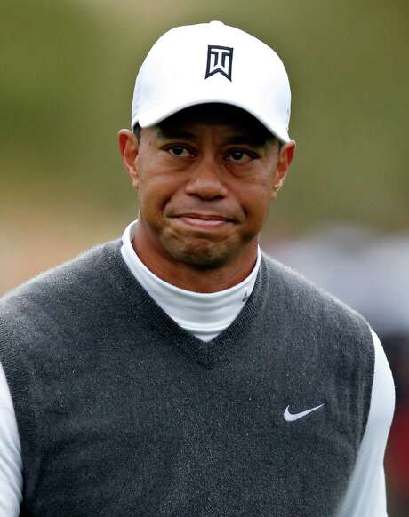 Tiger Woods grimaces after finishing the ninth hole during the second round of the Phoenix Open golf tournament, Friday, Jan. 30, 2015, in Scottsdale, Ariz. (AP Photo/Rick Scuteri) Photo: Rick Scuteri, FRE / FR157181 AP