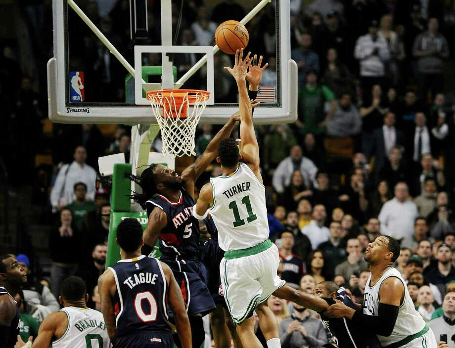 The Celtics' Evan Turner was closely guarded by the Hawks' DeMarre Carroll on his game-winning shot. Photo: Jessica Hill, FRE / FR125654 AP
