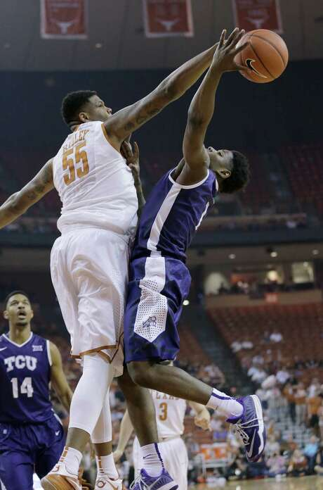 UT's Cameron Ridley, left, rejects a shot by TCU's Chauncey Collins during Ridley's 15-point, 12-rebound, four-block masterpiece Wednesday night. Photo: Eric Gay, STF / AP
