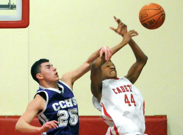 Catholic Central High School 's Anthony Mack and  Albany Academy's Hameir Wright battle for a rebound during their boy's high school basketball game on Wednesday Feb. 11, 2015 in Albany, N.Y.  (Michael P. Farrell/Times Union) Photo: Michael P. Farrell / 00030563A