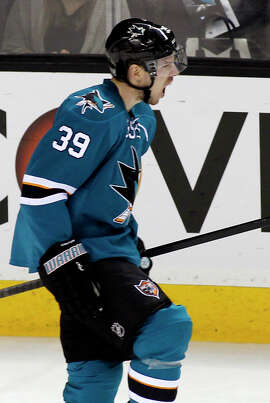 San Jose Sharks' Logan Couture reacts after scoring a goal against the Washington Capitals during the second period of an NHL hockey game, Wednesday, Feb. 11, 2015, in San Jose, Calif. (AP Photo/George Nikitin)