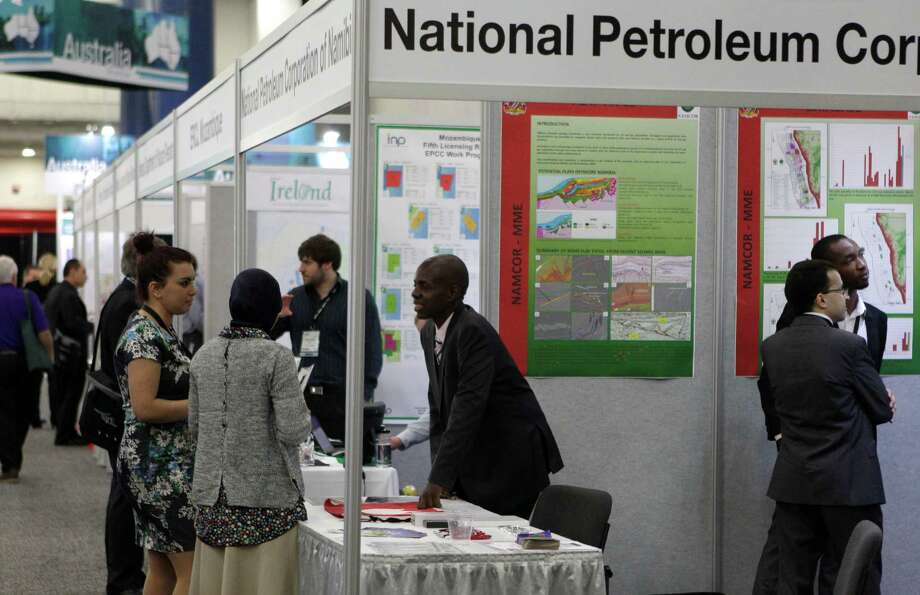 People are shown at the National Petroleum Corp. booth as they attend the international expo at the NAPE conference at George R. Brown Convention Center, 1001 Avenida De Las Americas, Wednesday, Feb. 11, 2015, in Houston. Photo: Melissa Phillip, Houston Chronicle / © 2014  Houston Chronicle