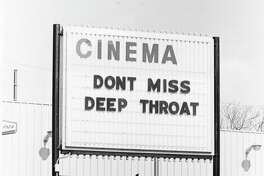 A theater marquee advertises the film 'Deep Throat', starring Linda Lovelace (1949 - 2002), directed by Gerard Damiano, 1972.