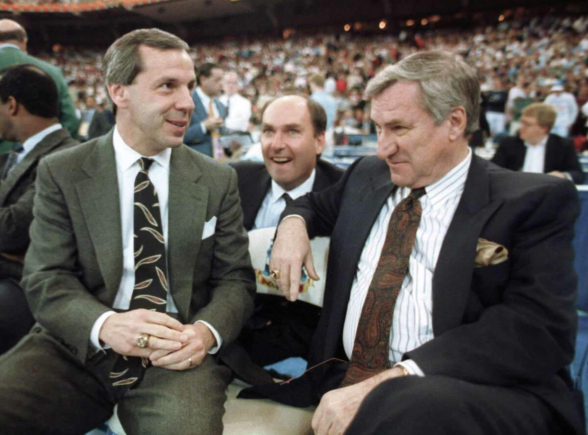 """FILE - In this March 30, 1991 file photo, Kansas coach Roy Williams, left, and North Carolina coach Dean Smith talk before the start of the first NCAA national semi-final game in Indianapolis, Ind. Smith, the North Carolina basketball coaching great who won two national championships, died """"peacefully"""" at his home Saturday night, Feb. 7, 2015, the school said in a statement Sunday from Smith's family. He was 83."""
