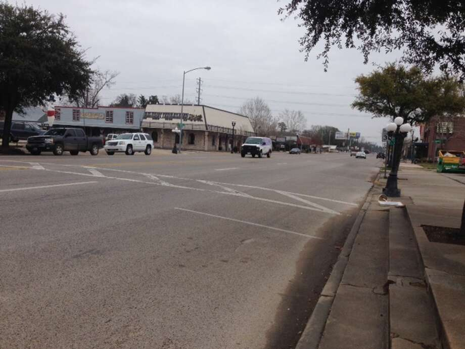 The influx of residents on weekends has led to traffic congestion on many of the side streets that feed off Main and Commerce streets in downtown Tomball. Photo: Bryan Kirk