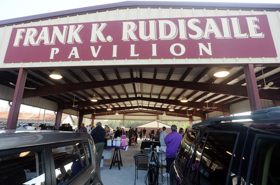 Shoppers browse the wares at Frank K. Rudisaile Pavilion in Silsbee during the Hardin County Texas Auction Trunk Sale. The Silsbee Famers Market will return to downtown Silsbee later this month. Photo: Jake Daniels / ©2014 The Beaumont Enterprise/Jake Daniels