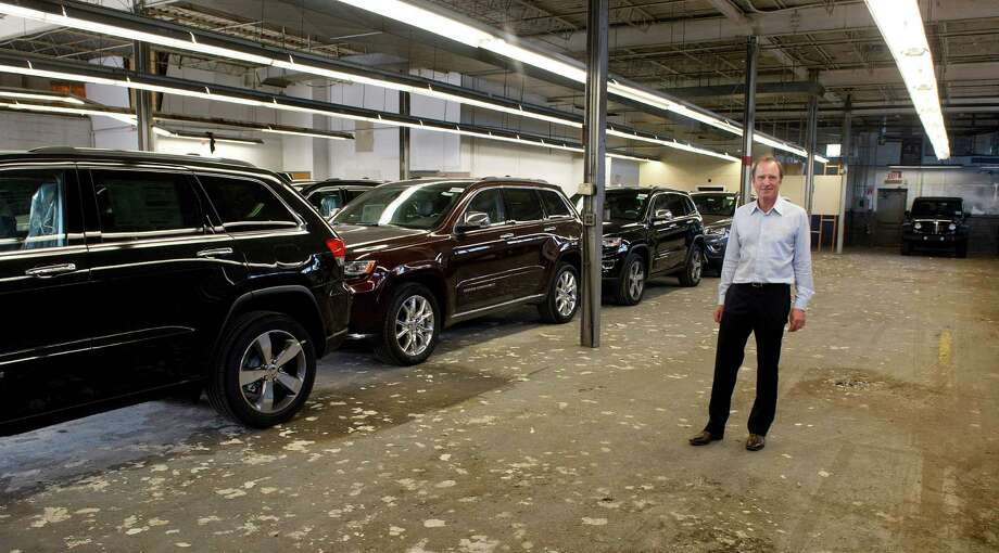 Jon Wade, owner of Jeep Chrysler Dodge City in Greenwich, secured a warehouse in West Stamford last year to store new vehicles. He says 2015 is already shaping up as a potential record year for his dealership. Photo: Lindsay Perry / Stamford Advocate