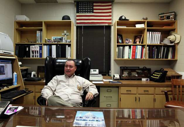 Schleicher County Sheriff David Doran reflects on the turmoil of dealing with Warren Jeffs and his followers from the Fundamentalist Church of Jesus Christ of Latter-Day Saints in Eldorado, Texas on Nov. 29, 2012. Doran has dealt with the group since their arrival in 2003 and is glad that the town is now starting to return to normal. Photo: Kin Man Hui, San Antonio Express-News / ©2012 San Antonio Express-News