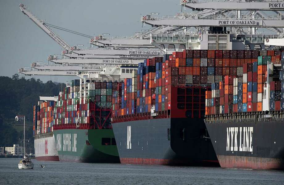 Container ships sit moored at the Port of Oakland last week as a work slowdown at West Coast ports continues amid dockworker negotiations. Photo: Justin Sullivan / Getty Images / 2015 Getty Images