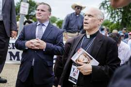 San Francisco Archbishop Salvatore Cordileone, right, and Brian Brown, left, march organizer and president of the National Organization of Marriage, kneel to pray as participants in the March for Marriage gather across from the Supreme Court in Washington, DC on June 19, 2014. Speakers at the rally and march promoted the definition of marriage as between a man and a woman, and pushed back against the notion that public opinion is heavily in favor of revoking restrictions against gay marriage.  (Photo by T.J. Kirkpatrick/Special to The Chronicle)
