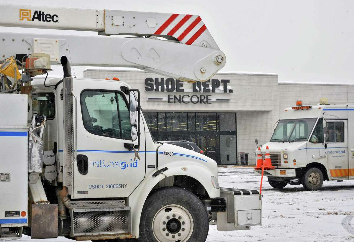 National Grid crews gathered outside Rotterdam Square Mall Thursday, Feb. 12, 2015, in Rotterdam, N.Y. National Grid confirmed Thursday that power was shut off at the Rotterdam Square Mall Thursday morning due to a still-unpaid electricity bill. (John Carl D'Annibale / Times Union)