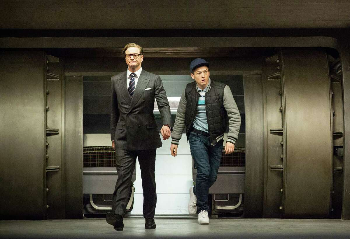 """Suave spy Harry (Colin Firth, left) tries to do right by helping working-class Eggsy (Taron Egerton) try out for a spy gig in """"Kingsman: The Secret Service."""""""