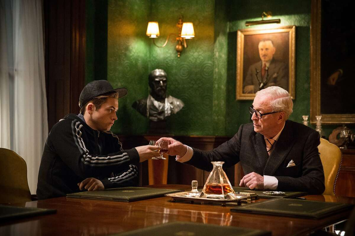 """In this image released by 20th Century Fox, Taron Egerton, left, and Michael Caine appear in a scene from """"Kingsman: The Secret Service."""" (AP Photo/20th Century Fox, Jaap Buitendijk)"""