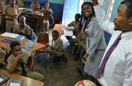 Jamaican educators say boys in single-sex schools do better than those in co-educational ones.