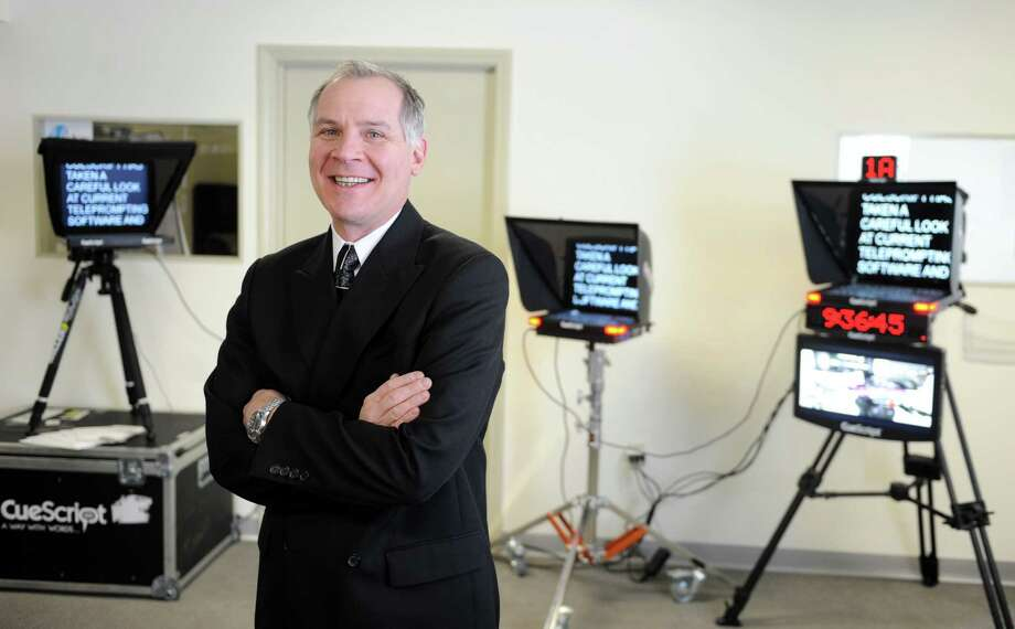 Michael Accardi, President, CueScript, Inc. stands in front of tele-prompters the company produces at their headquarters in Fairfield, Conn. Photo: Autumn Driscoll / Connecticut Post