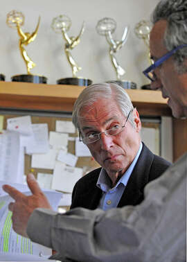 """""""60 Minutes"""" correspondent Bob Simon, was killed in a car crash in New York on Wednesday. In this March 24, 2010 photo released by CBS, """"60 Minutes"""" correspondent Bob Simon, speaks with a news producer at the CBS Broadcast Center in New York. CBS says Simon was killed in a car crash on Wednesday, Feb. 11, 2015, in Manhattan. Police say a town car in which he was a passenger hit another car. He was 73. (AP Photo/CBS, John Paul Filo)"""