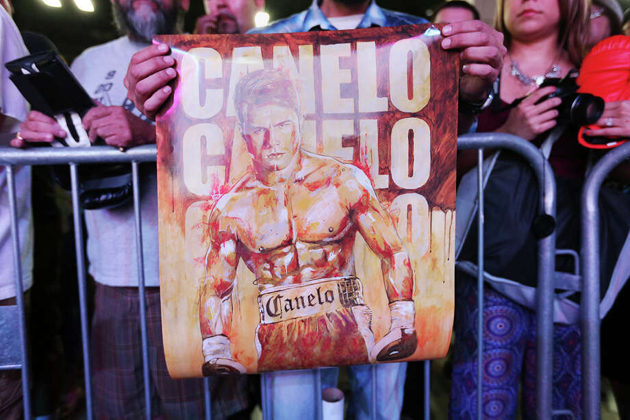 "A fans holds a poster of professional boxer Saul ""Canelo"" Alvarez before his appearance at the People En Espanol Festival at the Convention Center on Aug. 31, 2014. Promoters say Alvarez will fight James Kirkland either May 2 or May 9 at the Alamodome. Photo: Jerry Lara /San Antonio Express-News / @San Antonio Express-News"