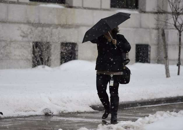 Snow returned to Albany Thursday afternoon with a lengthy squall but no new accumulation. (Skip Dickstein / Times Union)