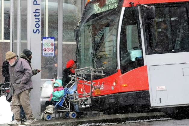 Travelers wait, get on and off the CDTA buses during a light snowfall on State Street Thursday Feb. 12, 2015 in Albany, N.Y. (Michael P. Farrell/Times Union) Photo: Michael P. Farrell / 00030599A