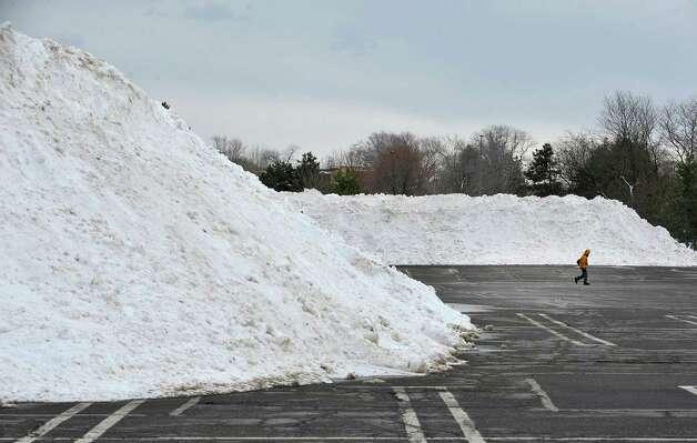 Snow is piled high in the parking lot of Colonie Center mall on Thursday, Feb. 12, 2015, in Albany, N.Y.  (Paul Buckowski / Times Union) Photo: Paul Buckowski / 00030599A