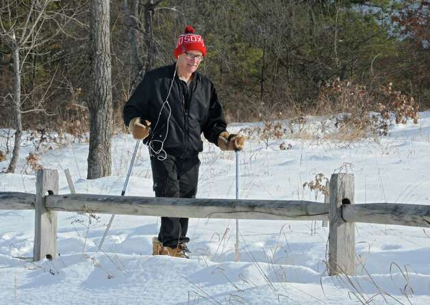 Ken LaPenta of Niskayuna snowshoes through the Albany Pine Bush Preserve on Thursday, Feb. 12, 2015 in Albany, N.Y. LaPenta wanted to get some exercise in before the really cold weather came. (Lori Van Buren / Times Union) Photo: Lori Van Buren / 00030599A