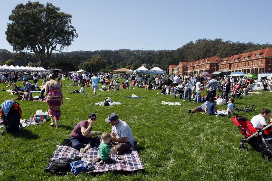 """People of all ages gather to enjoy the sunshine during the kick off of Off the Grid's """"Picnic at the Presidio"""" on April 6, 2014 in San Francisco, Calif. Food trucks, vendors and more descend on the lawn from 11 a.m to 4 p.m. every Sunday through October. Photo: The Chronicle"""
