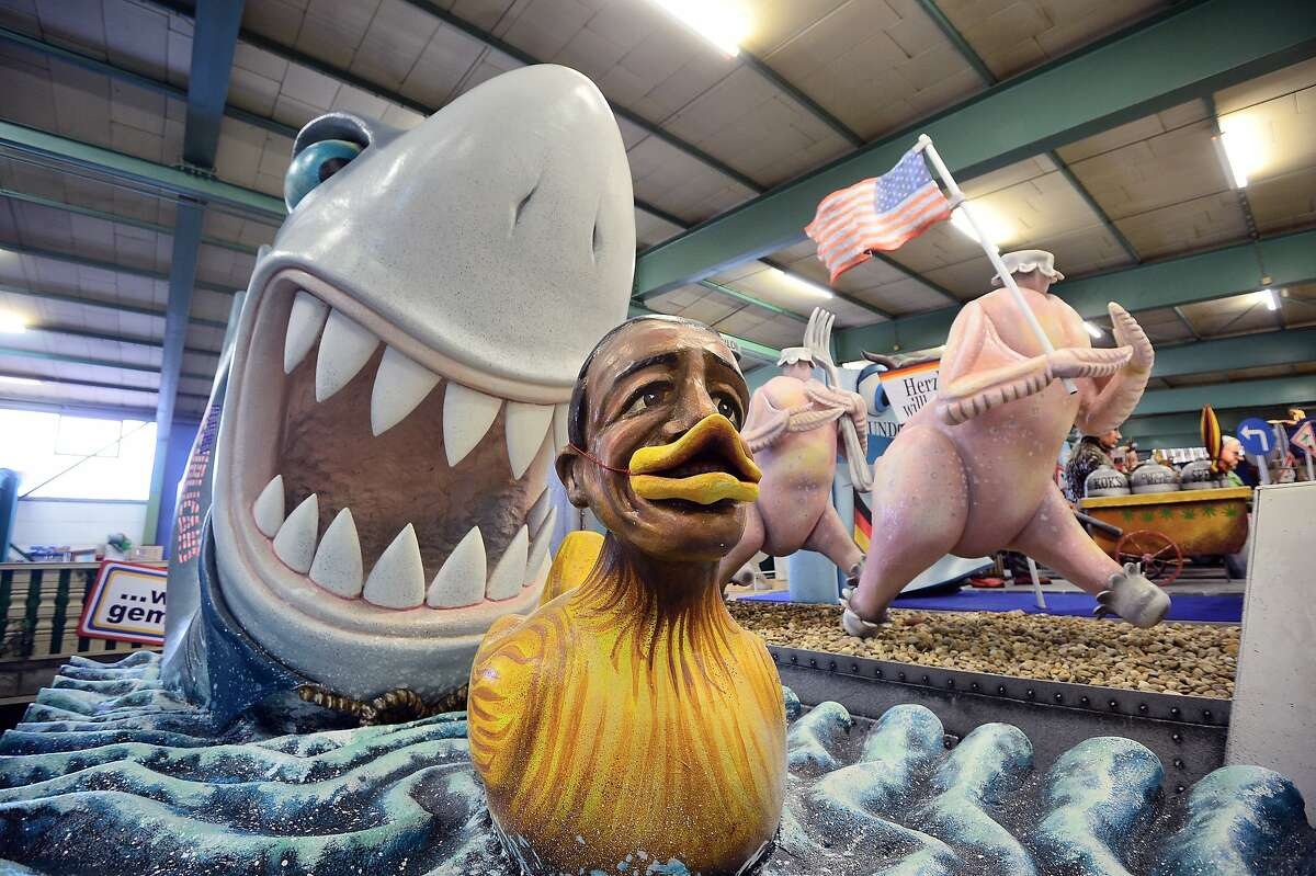 """WHERE'S KATY PERRY? A """"Lame Duck Obama"""" becomes shark chow on a carnival parade float in Mainz, Germany."""