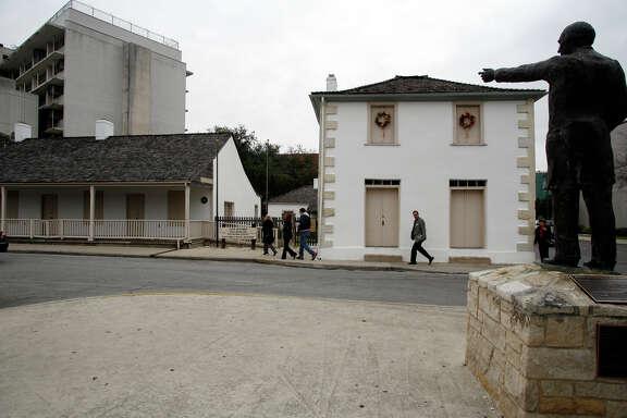 A statue of José Antonio Navarro overlooks the Navarro house in this 2007 file photo.