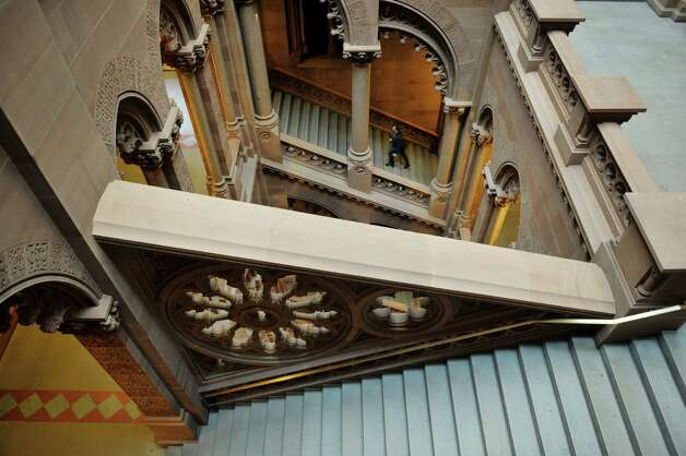 A man makes his way up the stairs from the second floor to the third floor on the Senate side at the Capitol on Tuesday, Dec. 16, 2014, in Albany, N.Y.   (Paul Buckowski / Times Union) Photo: Paul Buckowski / 00029841A