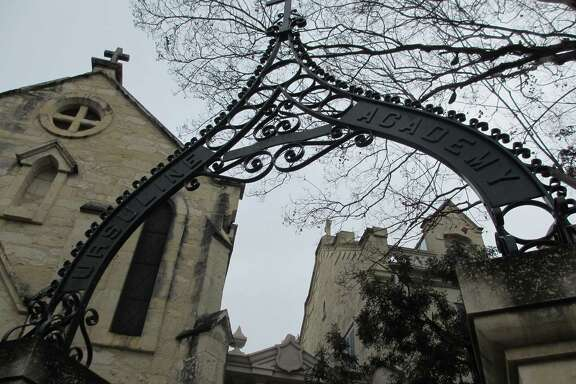 The iron gate on the back side of the Southwest School of Art, formerly the Southwest Craft Center, gives a hint to the history of the buildings across the street from the Central Library downtown. The buildings originally housed the Ursuline Academy (and the gates still bear that name), the city's first school for girls, in 1851.