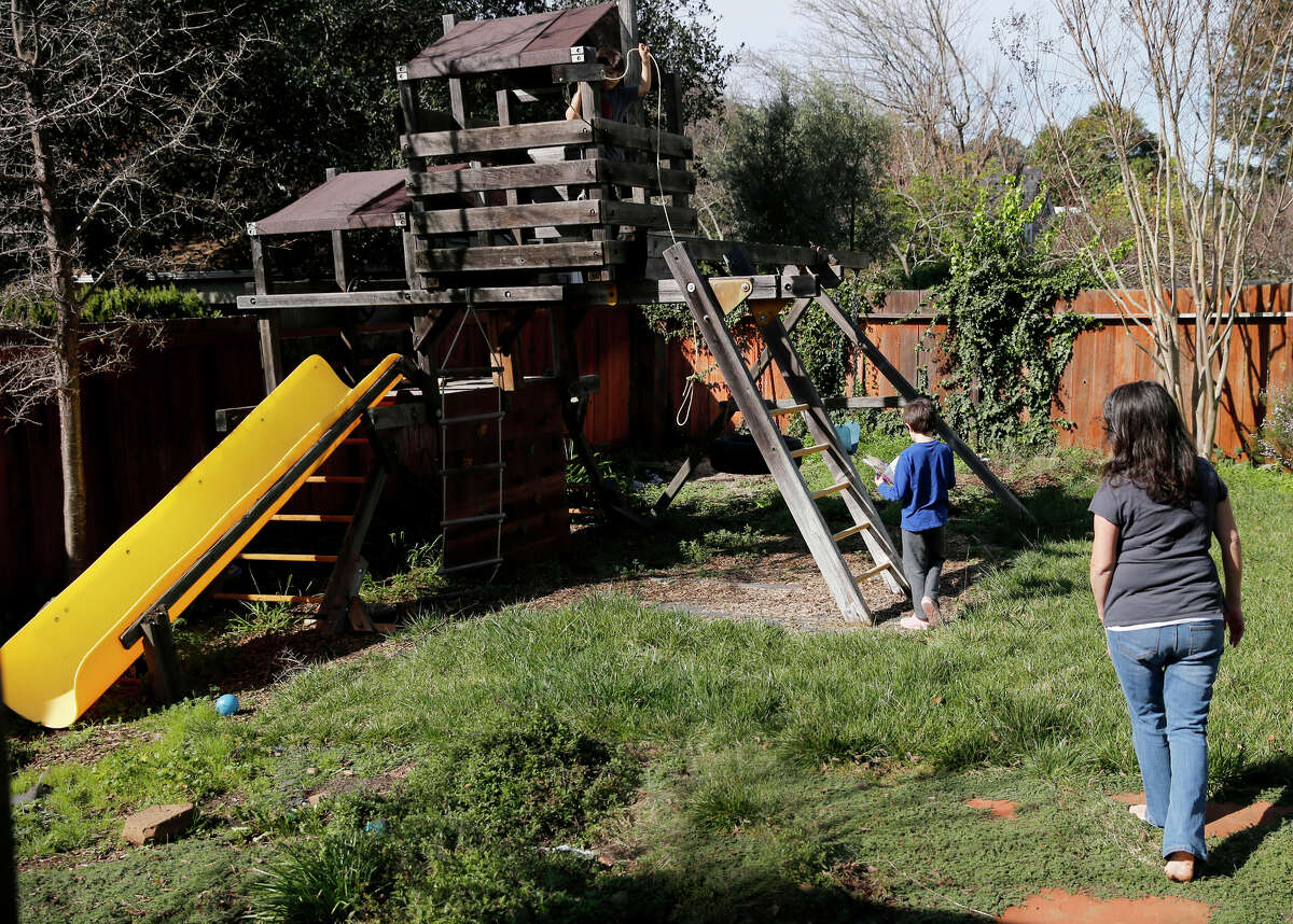 Julie Schiffman, who has endured criticism over her measles comments, watches her sons play at their Marin County home.