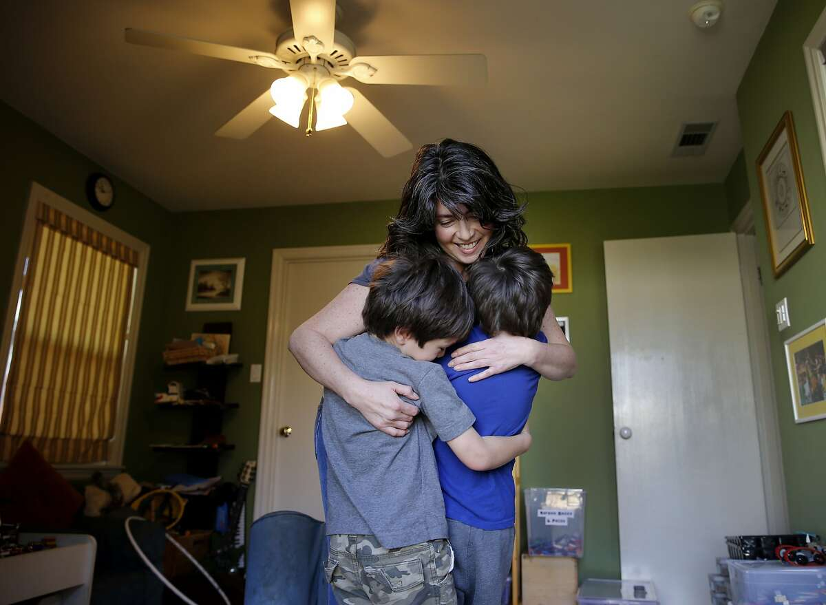 Julie Schiffman enjoys a group hug with her boys in the play room of her home Thursday February 12, 2015. Julie Schiffman is upset about the measles-crazed media mania over her comments which were misinterpreted about her home schooled children who have not been inoculated in Marin County, Calif.