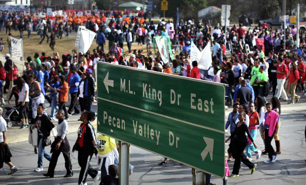 Walkers in the Martin Luther King, Jr. March follow MLK Blvd. in January 2013 where it turns and goes under I-10.
