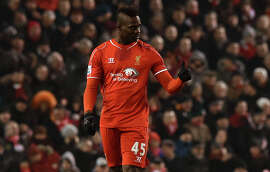 Liverpool's Mario Balotelli gives a play-it-cool thumbs up after scoring the game-winner against Tottenham Hotspur.