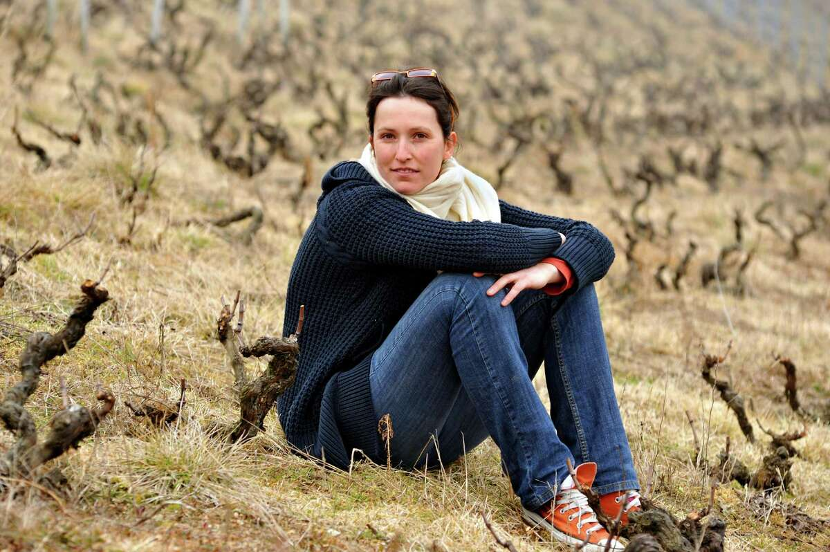Anne-Sophie Dubois sits amid old vines in the Beaujolais commune of Fleurie. She is part of a new generation bringing top winemaking to the Beaujolais area.